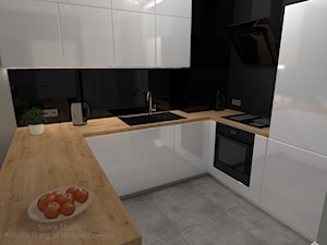 Aranżacja mieszkania - Mała zamknięta czarna kuchnia w kształcie litery u, styl nowoczesny - zdjęcie od SUARE STUDIO Natalia Margraf-Wojciechowska