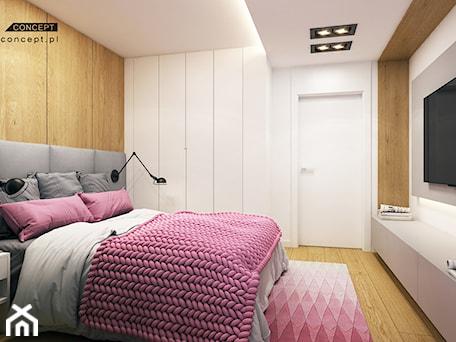 Aranżacje wnętrz - Sypialnia: Kolejny projekt mieszkania w Krakowie - Średnia biała sypialnia dla gości małżeńska, styl nowoczesny - BEFORECONCEPT. Przeglądaj, dodawaj i zapisuj najlepsze zdjęcia, pomysły i inspiracje designerskie. W bazie mamy już prawie milion fotografii!