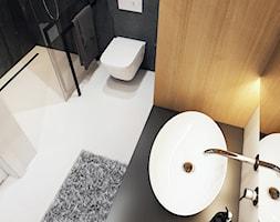 Projekt mieszkania w Olsztynie - Mała czarna łazienka na poddaszu w bloku w domu jednorodzinnym bez okna - zdjęcie od BEFORECONCEPT
