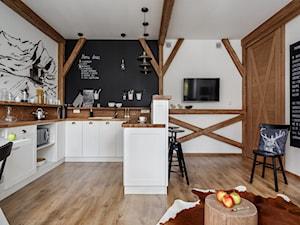 Apartament Granitica Platinium 8, Zakopane - Średnia otwarta biała czarna kuchnia w kształcie litery u z wyspą, styl skandynawski - zdjęcie od www.tatrytop.pl