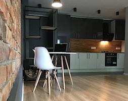 projekt mieszkania - Poznań, Dębiec - Średnia beżowa szara czarna kuchnia jednorzędowa w aneksie, styl nowojorski - zdjęcie od NKW - wnętrza