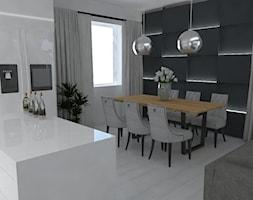 Apartament Warszawa - Średnia otwarta biała czarna jadalnia w salonie, styl nowoczesny - zdjęcie od Studio WYMIAR