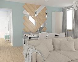 ściana z płytkami drewnopodobnymi - zdjęcie od Studio WYMIAR