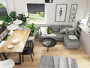 SALON Z KUCHNIĄ 32m2 - Mały biały salon z bibiloteczką z kuchnią z jadalnią - zdjęcie od SYMETRIA | pracownia architektury
