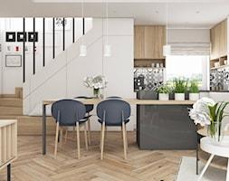 MIESZKANIE W MOGILNIE | 32m2 - Średnia otwarta biała jadalnia w kuchni w salonie - zdjęcie od SYMETRIA | pracownia architektury