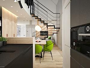 PROJEKT W17 etap I - Mała otwarta biała czarna kuchnia dwurzędowa w aneksie z oknem - zdjęcie od SYMETRIA   pracownia architektury