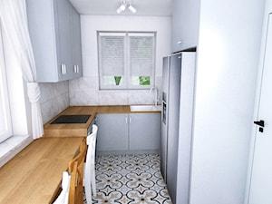 Dom w Różynach 2018 - Mała zamknięta wąska biała kuchnia w kształcie litery l z oknem, styl eklektyczny - zdjęcie od WOJSZ studio