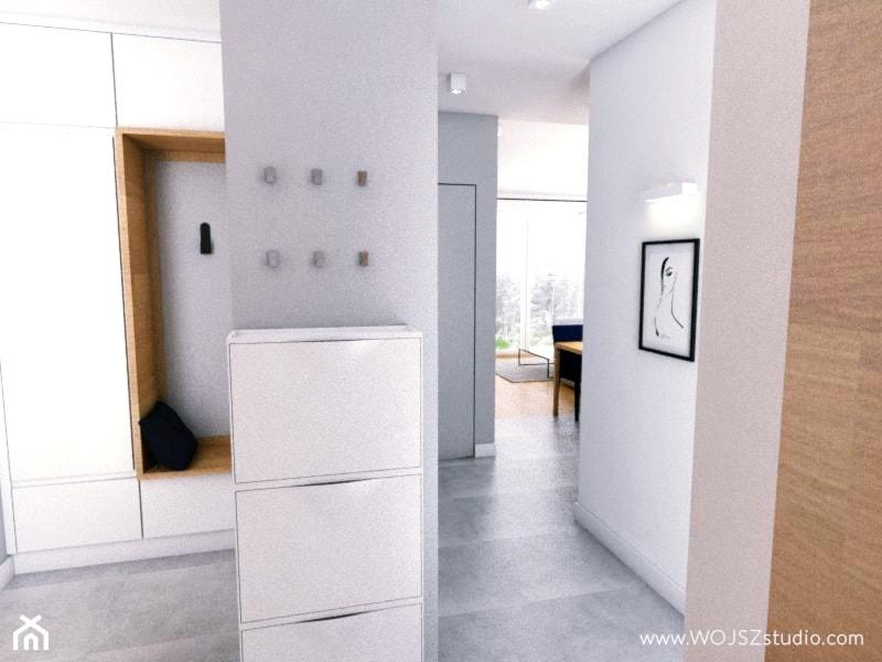 Granatowy akcent - Mały biały szary hol / przedpokój, styl nowoczesny - zdjęcie od WOJSZ studio