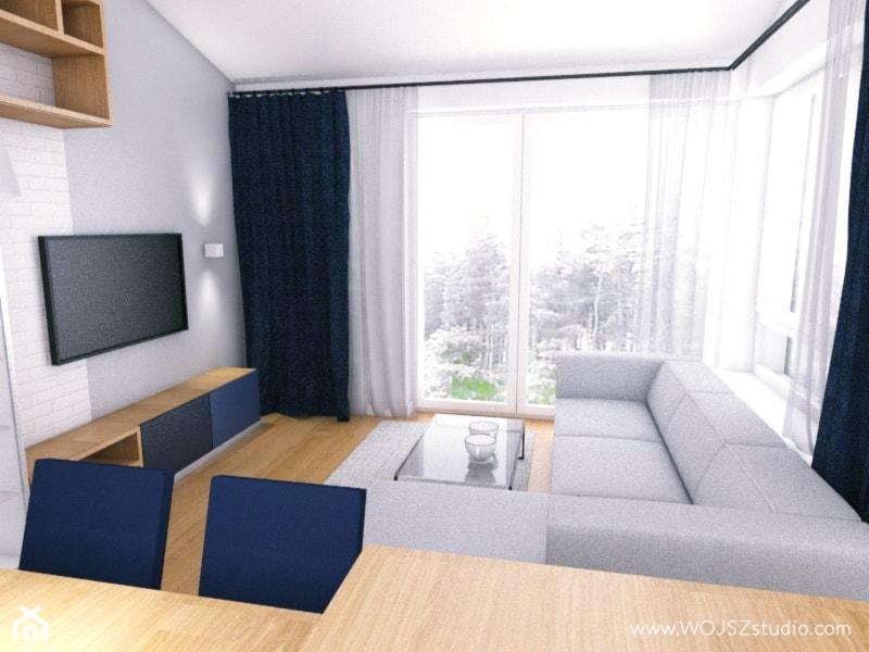 Granatowy akcent - Mały biały salon z jadalnią, styl industrialny - zdjęcie od WOJSZ studio