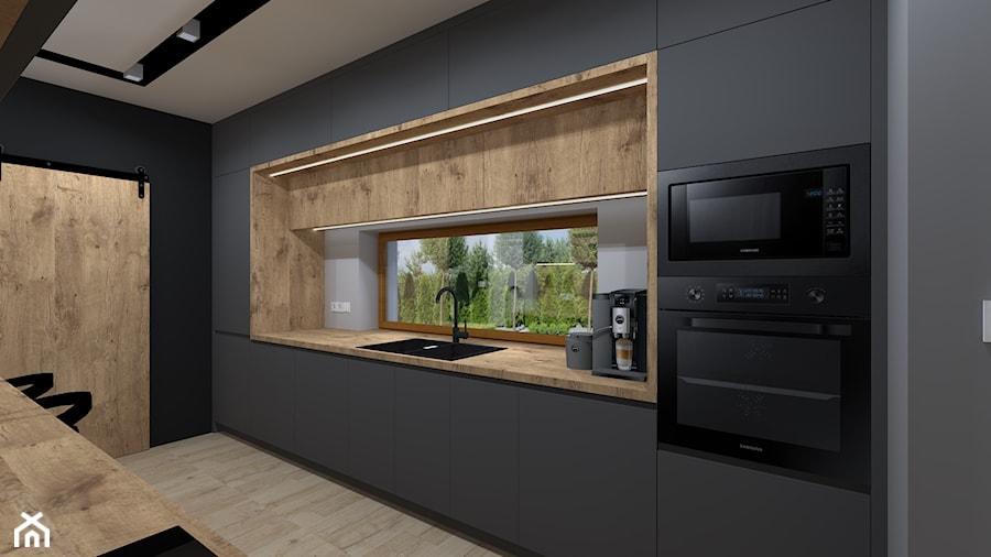 Dom pod Krakowem - Duża zamknięta czarna kuchnia dwurzędowa z oknem, styl nowoczesny - zdjęcie od iStudioo
