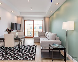 Apartament II na wynajem w Gdańsku - Mała otwarta biała zielona jadalnia w kuchni, styl skandynawski - zdjęcie od TO DO.