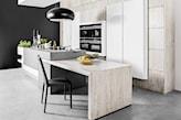 wyspa z betonu z drewnianym wbudowanym stołem kuchennym