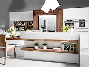 Jak urządzić funkcjonalną kuchnię z wyspą otwartą na salon?