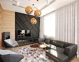 Nowoczesne mieszkanie w kamienicy - Średni czarny brązowy salon - zdjęcie od piodec