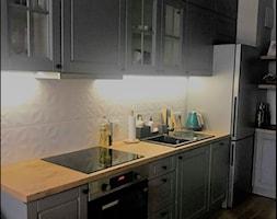 Warszawa os. Wilanów - Średnia otwarta szara kuchnia w kształcie litery l - zdjęcie od Firma Budowlana Malhaus Remonty i Wykończenia Wnętrz