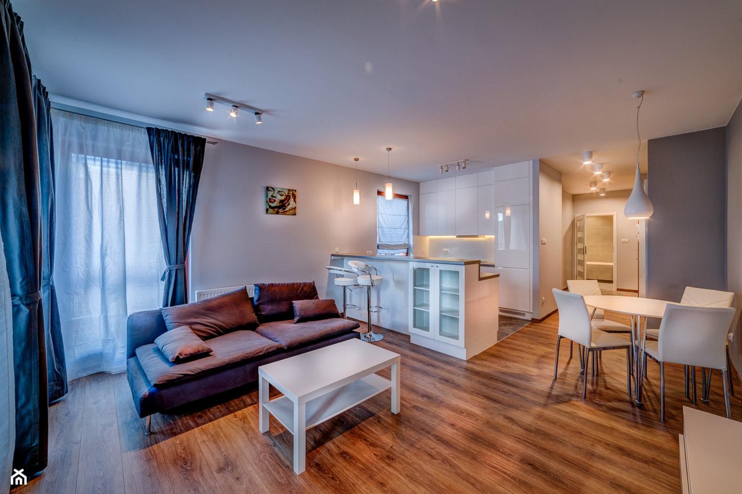 Mieszkanie pod wynajem Os. Garnizon - Średni szary biały salon z kuchnią z jadalnią, styl nowoczesny - zdjęcie od Bello Arte - Homebook