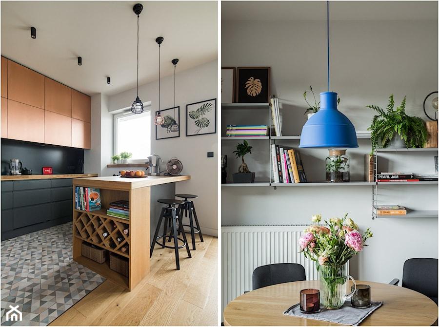 KAMION CROSS - Średnia biała czarna kuchnia jednorzędowa w aneksie z wyspą z oknem, styl eklektyczny - zdjęcie od Qbik Design