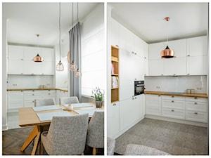 Żoliborz - Duża otwarta biała kuchnia w kształcie litery l w aneksie z oknem, styl skandynawski - zdjęcie od Qbik Design