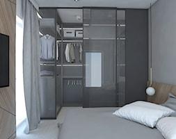 Z betonem w tle - Mała szara sypialnia małżeńska z garderobą, styl nowoczesny - zdjęcie od Studio projektowania wnętrz''Studio Aranżacji''