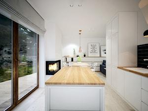 Europejska Resident - Średnia otwarta biała kuchnia jednorzędowa w aneksie z wyspą z oknem, styl skandynawski - zdjęcie od Studio projektowania wnętrz''Studio Aranżacji''