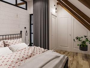 Sypialnia na poddaszu w domu jednorodzinnym - zdjęcie od Art & Deco Design