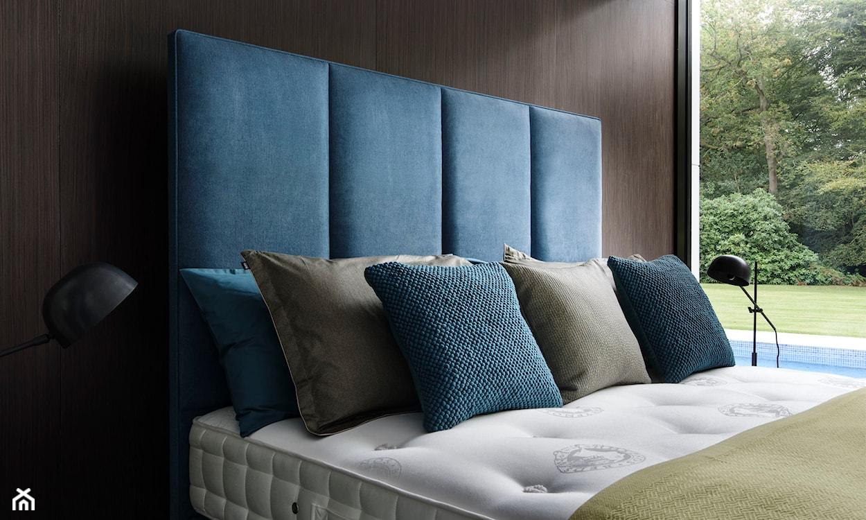 elegancki zagłówek łóżka ozdobiony pikowaniem