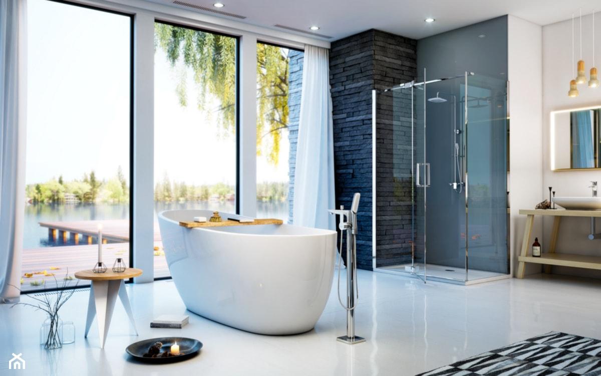 duża łazienka z prysznicem i wanną wolnostojącą w domu jednorodzinnym
