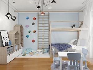 Pokoje najmłodszych\ chłopiec i jego miejsce do pracy i zabawy