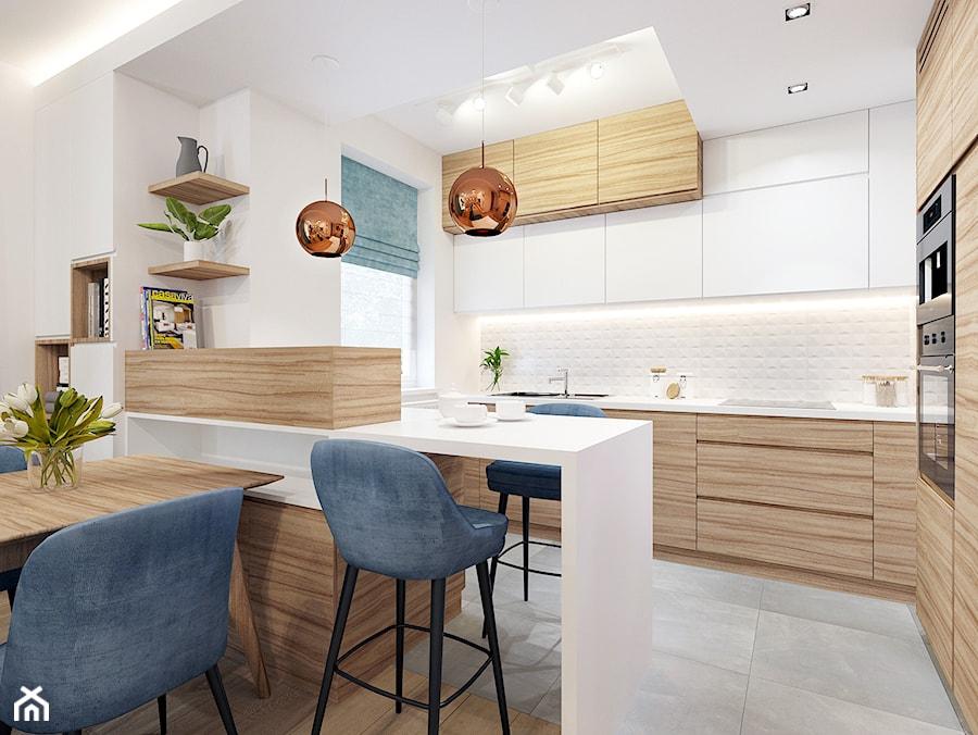 Kuchnia w apartamencie Soft Blue. - zdjęcie od NEFA Architekci
