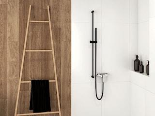 Czarne dodatki do minimalistycznej łazienki - jak je wybrać?
