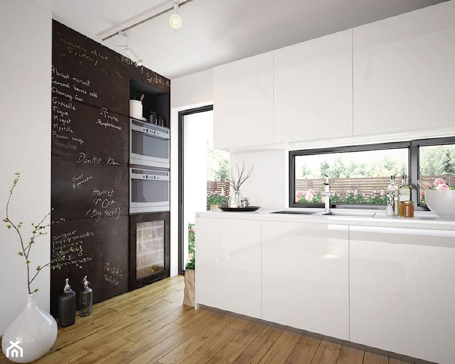 Kuchnia - Średnia otwarta biała kuchnia dwurzędowa w aneksie z oknem, styl nowoczesny - zdjęcie od REHAU