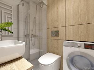 Łazienka z drewnianym motywem przewodnim