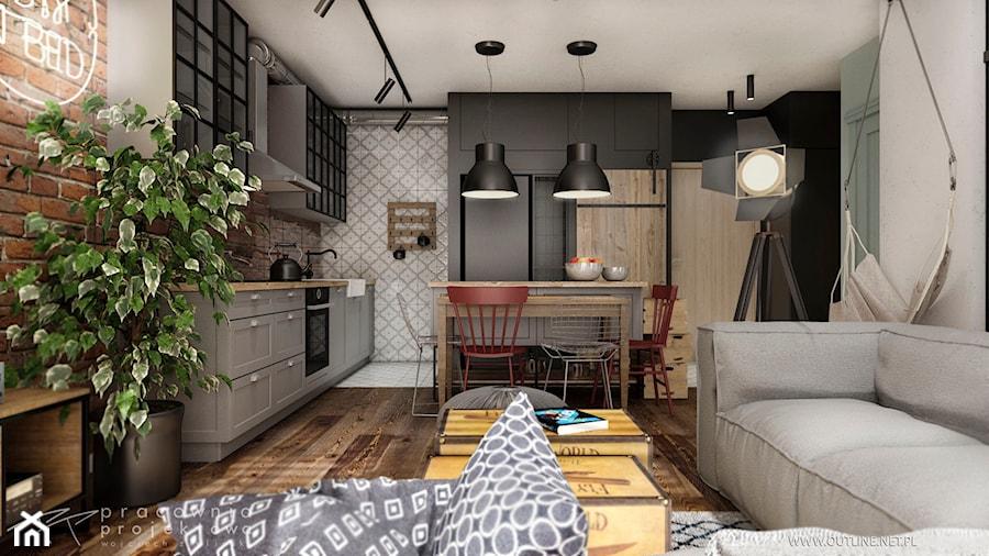 Mieszkanie w stylu industrialnym - Mały szary czarny salon z kuchnią z jadalnią, styl industrialny - zdjęcie od Pracownia Projektowa Wojciech Zieliński