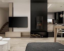 Wnętrze domu jednorodzinnego w stylu nowoczesnym - Średni szary czarny salon z kuchnią z jadalnią, styl nowoczesny - zdjęcie od Pracownia Projektowa Wojciech Zieliński