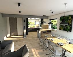 Dom pod Koninem - Duża otwarta szara jadalnia w salonie, styl industrialny - zdjęcie od P.S.-projekt