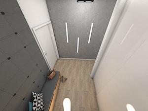 Wiatrołap z betonem i dekoracyjnym oświetleniem - Mały biały szary hol / przedpokój, styl nowoczesny - zdjęcie od P.S.-projekt