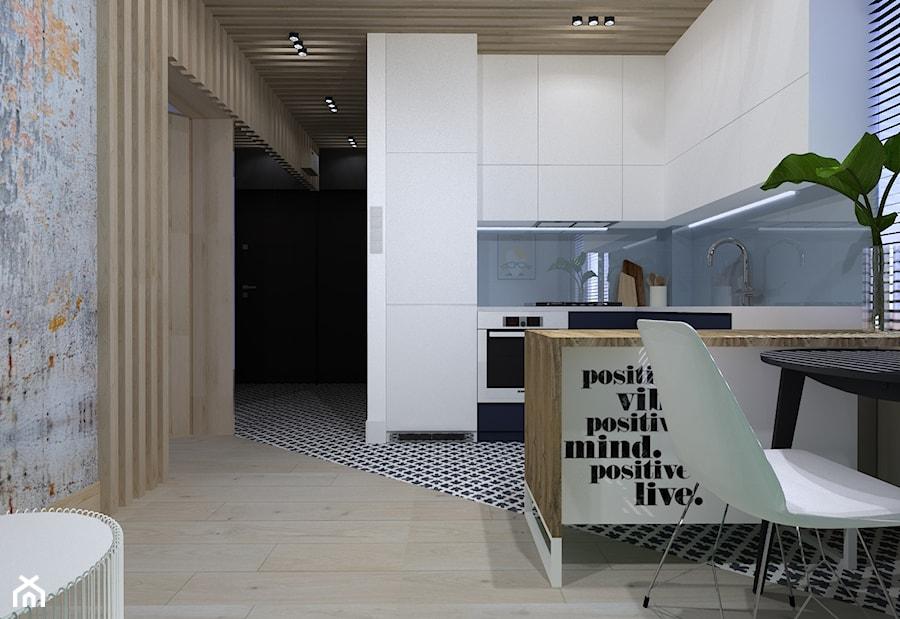 Aranżacje wnętrz - Kuchnia: kawalerka 35m - Mała otwarta niebieska kuchnia w kształcie litery u z oknem - totamstudio. Przeglądaj, dodawaj i zapisuj najlepsze zdjęcia, pomysły i inspiracje designerskie. W bazie mamy już prawie milion fotografii!
