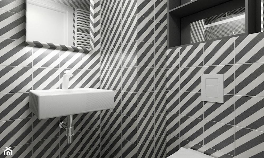 Niewielka łazienka z geometrycznym wykończeniem