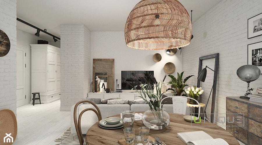 Aranżacje wnętrz - Jadalnia: Mieszkanie - Duża otwarta biała jadalnia w salonie, styl skandynawski - UNIQUE INTERIOR DESIGN. Przeglądaj, dodawaj i zapisuj najlepsze zdjęcia, pomysły i inspiracje designerskie. W bazie mamy już prawie milion fotografii!