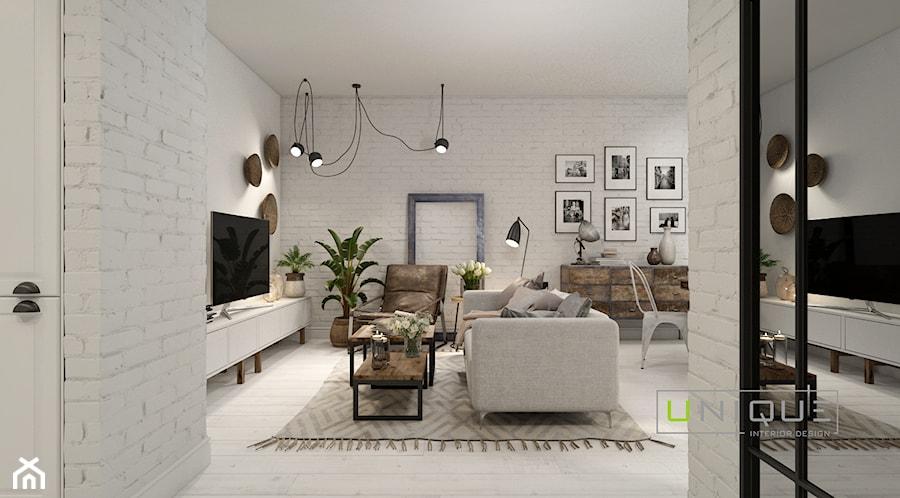 Mieszkanie z elementami w stylu BOHO - Średni biały salon, styl skandynawski - zdjęcie od UNIQUE INTERIOR DESIGN