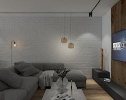 Przebudowa domu - Mały biały brązowy salon, styl industrialny - zdjęcie od UNIQUE INTERIOR DESIGN