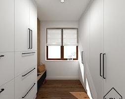 Salon z ukrytą garderobą - Garderoba, styl minimalistyczny - zdjęcie od KRU design - Homebook