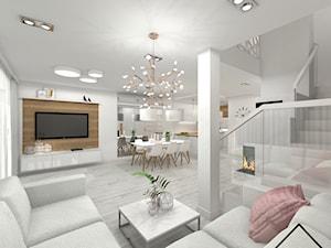 Salon z jadalnią w bieli i drewnie