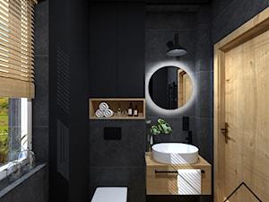 Czerń i drewno w łazience