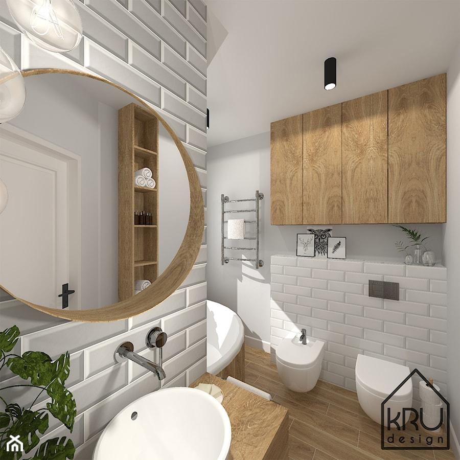 Aranżacje wnętrz - Łazienka: Łazienka w cegiełce - Średnia szara łazienka w bloku w domu jednorodzinnym bez okna, styl skandynawski - KRU design . Przeglądaj, dodawaj i zapisuj najlepsze zdjęcia, pomysły i inspiracje designerskie. W bazie mamy już prawie milion fotografii!