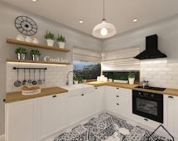 Kuchnia patchwork - Średnia otwarta biała szara kuchnia w kształcie litery l z oknem, styl skandynawski - zdjęcie od KRU design