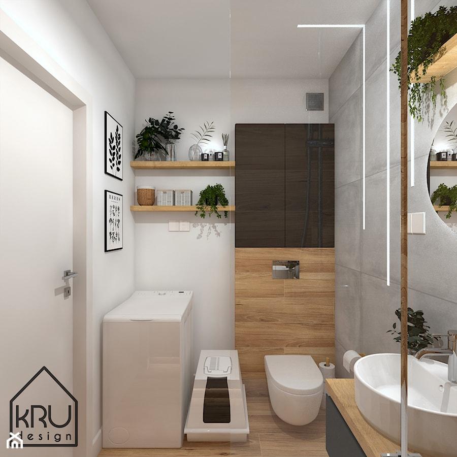 Łazienka z oświetleniem liniowym - Mała szara łazienka w bloku w domu jednorodzinnym bez okna, styl skandynawski - zdjęcie od KRU design