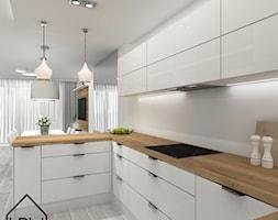 Biała kuchnia styl nowoczesny - Średnia biała kuchnia w kształcie litery g w aneksie z wyspą, styl nowoczesny - zdjęcie od KRU design