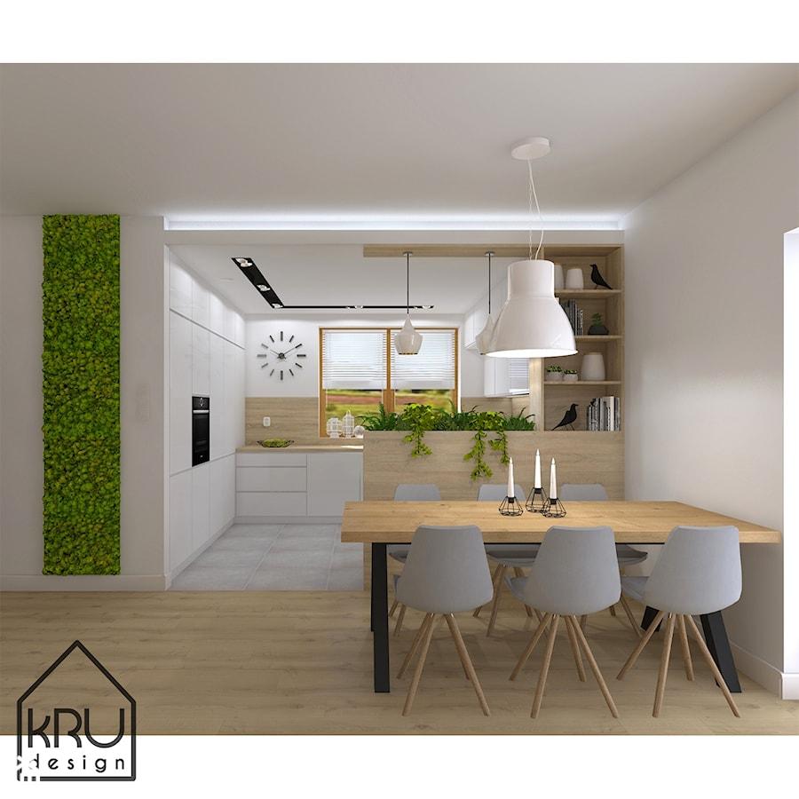 Rośliny w kuchni - Średnia otwarta biała kuchnia w kształcie litery l z oknem, styl nowoczesny - zdjęcie od KRU design