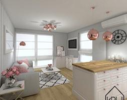 Salon z aneksem kuchennym - Mały szary salon z kuchnią, styl glamour - zdjęcie od KRU design